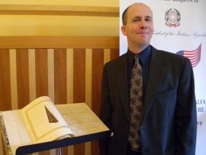 Josh Shapiro, grandson of WWII veteran Irving Tross returning the books