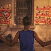 Walls of Freedom: Egyptian Graffiti Artists, the NewRevolutionaries